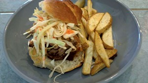 Maple Soul's pulled-pork sandwich with fries