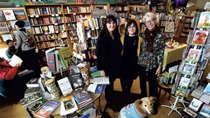 From left: Andrea Jones, Sandy Scott and Linda Ramsdell with canine staffer Boo at Galaxy Bookshop
