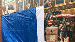 A tarp covering the mural after the Halloween vandalism