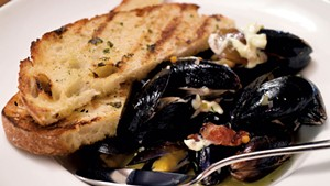 Cider-steamed mussels with grilled bread, smoked bacon and aioli