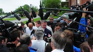 Media mob Clinton County, N.Y., District  Attorney Andrew Wylie in Plattsburgh.