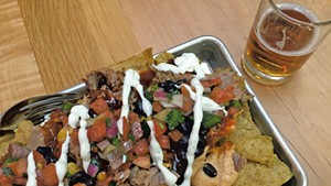 Hickory-smoked pork nachos and beer at the Otter Creek Brewing pub