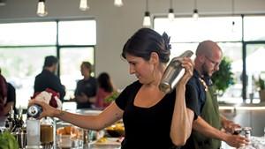 Bartender Emma Sanford and beverage director Sam Nelis preparing cocktails at Caledonia Spirits