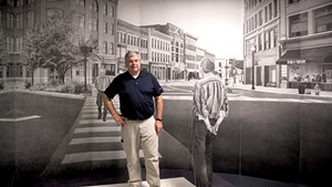 "Mark Foley Jr. standing in ""The Rutland Drawing"" installation, by William Ramage"