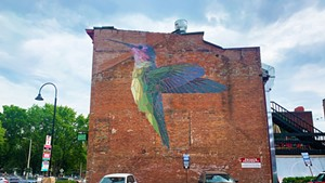 "Mary Lacy's ""Humminbird"" mural on the cornere of St. Paul and College streets in Burlington"