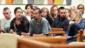 Desiree Herring and Felicia Kennison, center of front row, at their mother's arraignment Monday