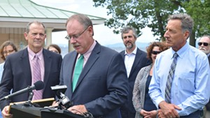 Curt Spalding, Region 1 administrator of the U.S. Environmental Protection Agency, speaks about a new  Lake Champlain cleanup agreement as Gov. Peter Shumlin looks on Friday at North Beach in Burlington.