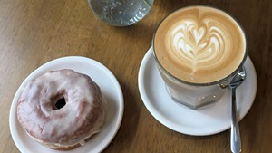 Latte and doughnut at Carrier Roasting