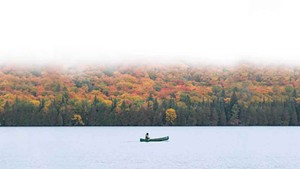 A canoeist out for a morning paddle in the Northeast Kingdom