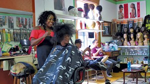 Mistre Newton gets her hair done at Burlington's Diversity Hair Salon.