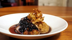 Duck with toasted polenta, a blueberry glaze and sunchoke chips at Sweetwaters