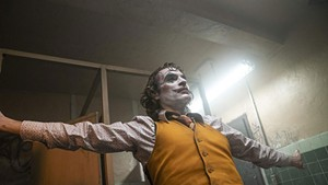 JOKER'S WILD Phoenix plays a would-be funnyman on the verge of mental collapse in Phillips' sort-of-superhero-adjacent drama.