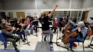 Anne Decker conducting a rehearsal of the Montpelier Chamber Orchestra