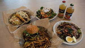 Clockwise from bottom: crispy chicken sandwich with hand-cut fries, Vermont hot dog, salmon salad, Bliss Bee sodas and a Sunrise grain bowl