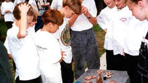 "Children look at their artworks to be buried under ""Zig Zag"" in 1994"