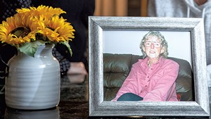 June (left) and Mary Kelly with a photo of their mother, Marilyn Kelly