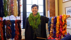 Heidi Fortsch of Brown Dog Fiber Arts in Chazy, NY holds up her work at Fiber Fair Friday