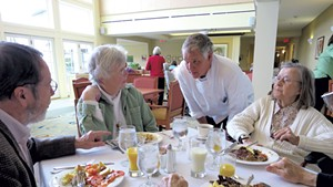 Bill Koucky visiting with residents in the dining room