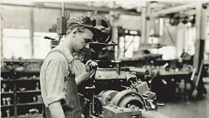 Factory worker operating a lathe