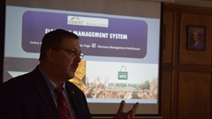 Secretary of State Jim Condos displays a new online voter-registration system Thursday at Montpelier City Hall.