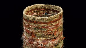Colorful finger-weave twined bag made by Vera Sheehan of the Elnu Tribe. This is an ancient, traditional way of making bags from milkweed or other fiber material.