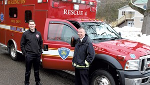 Firefighter Kyle Blake (left) and Fire Chief Steven Locke with the unmanned ambulance