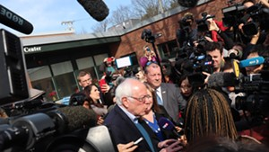 Bernie Sanders speaking to reporters outside the polls in Burlington on Tuesday