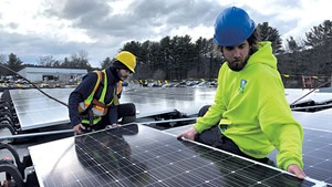 Norwich Solar workers installing a new PV system on a business in White River Junction last week