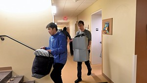 Middlebury College sophomores Aska Matsuda (left) and Sam deWolf moving out of their dorm