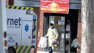 A worker helping to evacuate Burlington Health & Rehabilitation Center patients on Tuesday
