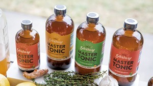 Fresh ingredients and finished Yerbary Master Tonic products