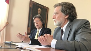 Administration economist Jeff Carr, left, and legislative economist Tom Kavet