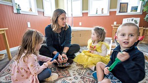 Kate Driver playing with kids in 2018 at Georgia's Next Generation