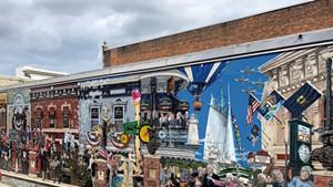 """Everyone Loves a Parade!"" mural in downtown Burlington"