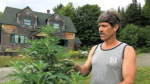 Sen. John Rodgers with a hemp plant