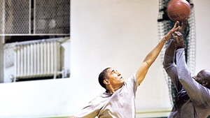 President Barack Obama playing basketball with personal aide Reggie Love