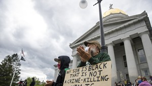 Protesters listen to speakers at a demonstration in Montpelier