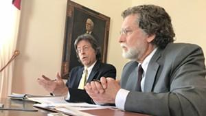 Administration economist Jeff Carr, left, and legislative economist Tom Kavet