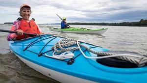 Catherine Frank (left) and Margaret Holden paddling on Lake Champlain