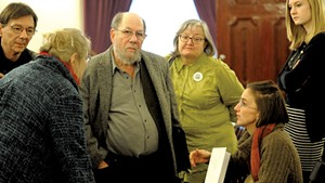 Sen. Jeanette White, left, speaking with Stuart Savel, center, and Emily Amanna, seated, from Vermont Home Grown
