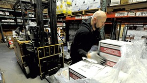 Matt Aubut unloading a pallet of vodka at the Department of Liquor Control warehouse