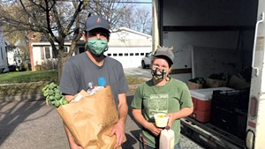 Kyle Doda (left) and Betsy Simpson of 1000 Stone Farm in Brookfield making a delivery in Burlington