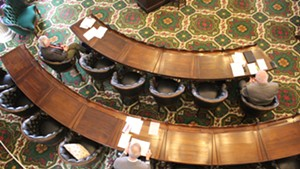 Lawmakers observing social distancing protocols in the Vermont Senate chamber in March