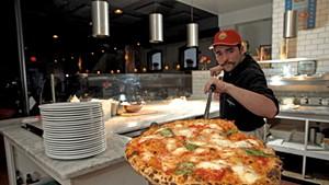Griffeon Chuba with a fresh pizza