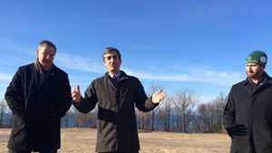 From left, Vermont Land Trust president Gil Livingston, Mayor Miro Weinberger and Parks, Recreation & Waterfront Director Jesse Bridges stand in front of the future parkland.