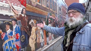 "Albert Petrarca by the ""Everyone Loves a Parade!"" mural"