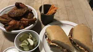 Eggplant hoagie and chicken wings from Prohibition Pig, with a hemp joint from Zenbarn Farms