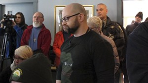 Max Misch at a press conference about the investigation into harassment of former state representative Kiah Morris
