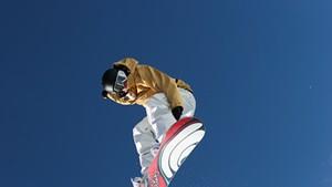 A snowboarder on a Burton board