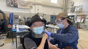 Gốc Văn Trần gets vaccinated for COVID-19 at the Winooski Armory